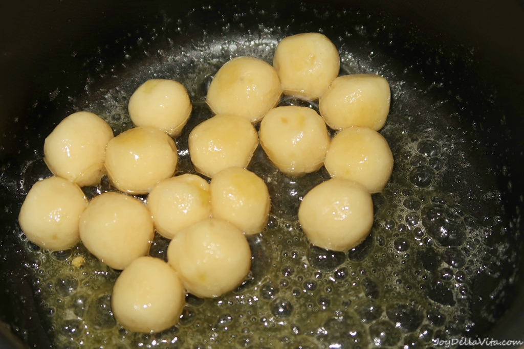 brown butter in a pan, toss and turn the freshly cooked gnocchi. add sage leaves if you like
