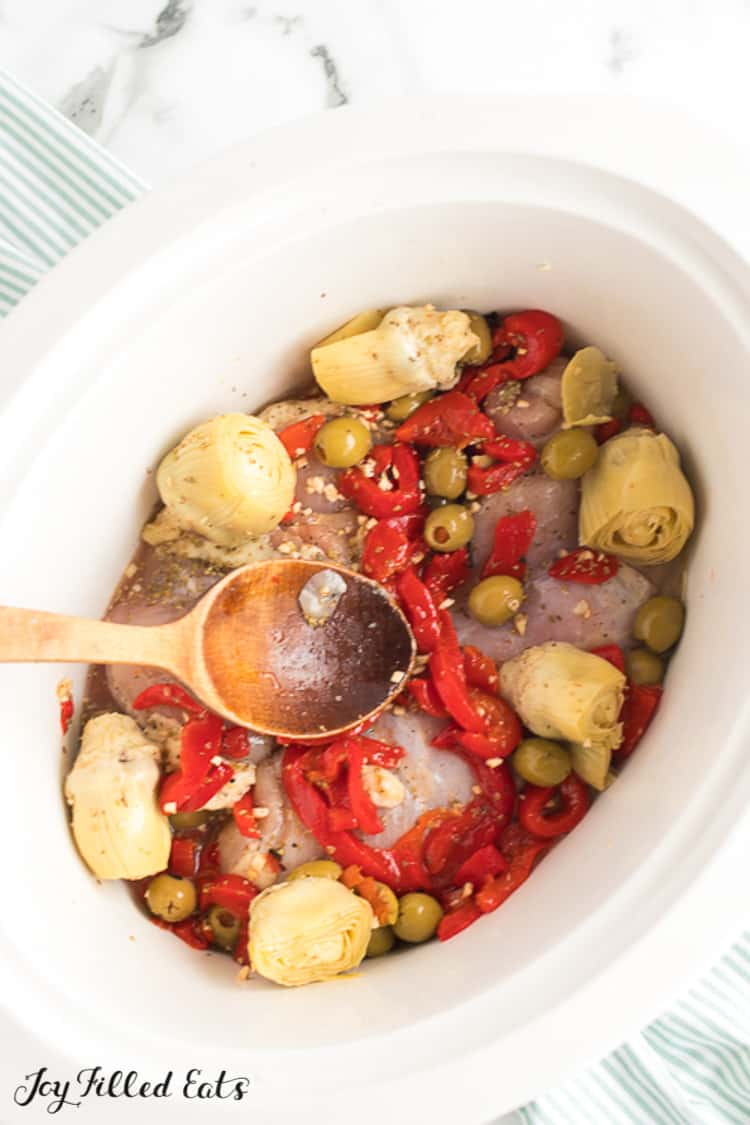 chicken thighs, artichokes, peppers, olives, and garlic in a crock pot