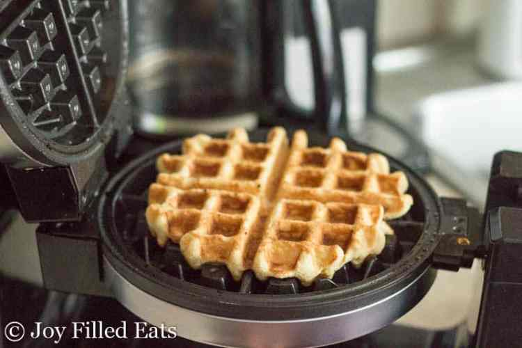 Cooked coconut flour waffle in the waffle iron