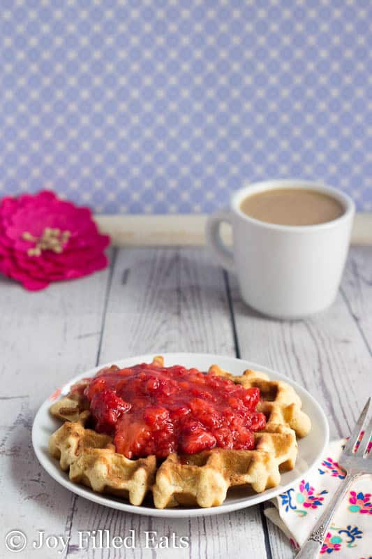 Coconut Flour Waffles with Strawberry Sauce on a white plate