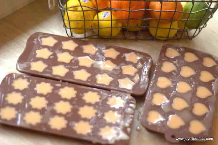 silicone gummy molds with the orange gummy mixture