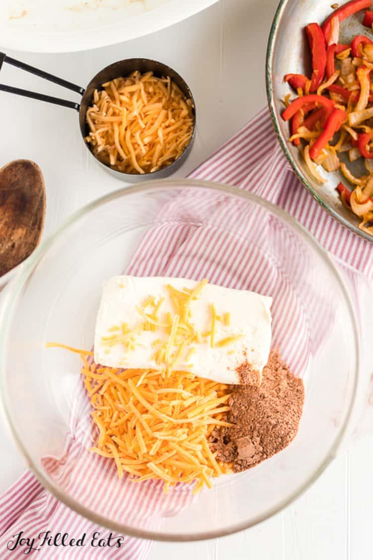 bowl with cream cheese, fajita seasoning, and cheddar