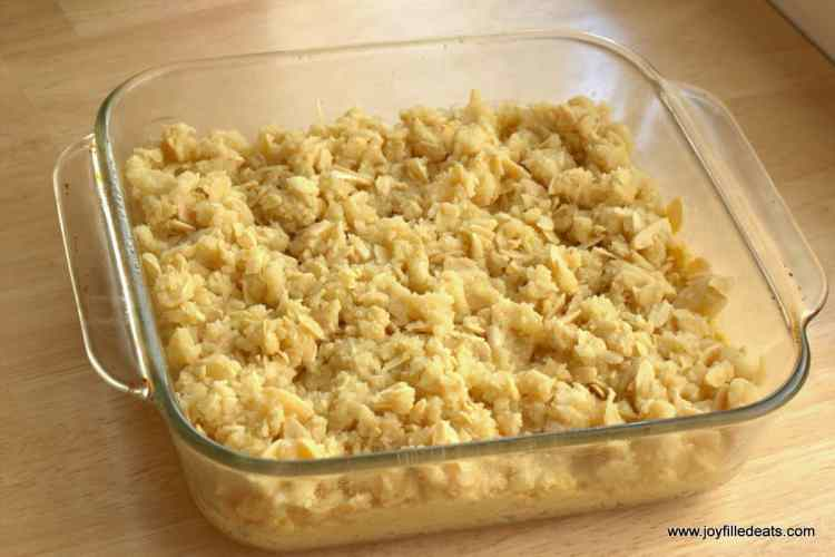 unbaked Almond Crumb Cake in a glass pyrex