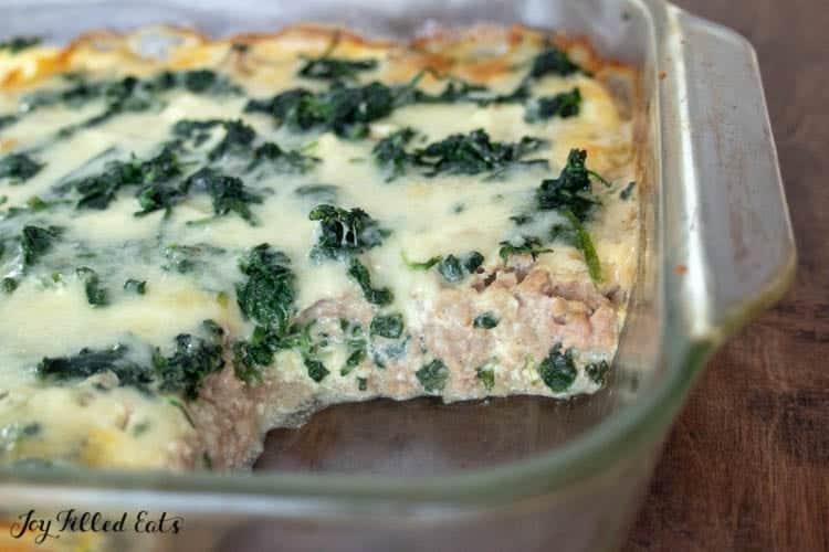 keto lasagna with a piece missing