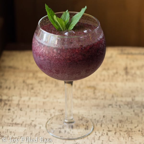 Frozen Blueberry Mojito - Low Carb & Sugar Free. This refreshing summer beverage is great with or without the rum. It is added sugar free. With less than 7 net carbs this Blueberry Mojito is worth it.