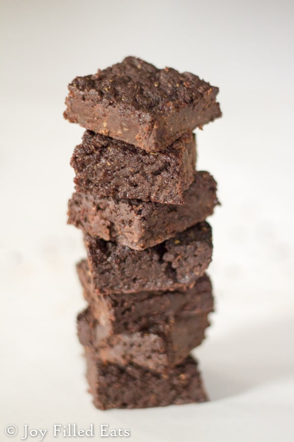 a tall stack of fudgy brownies with coconut oil