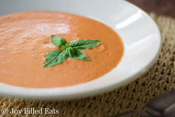 This rich, creamy Tomato Basil Soup uses fresh tomatoes & is ready in about 15 min. The taste is restaurant quality. It is low carb, grain free, & THM S.