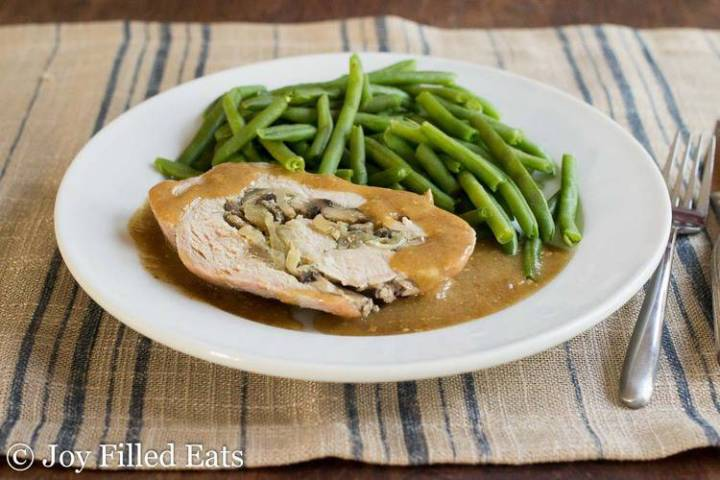 Stuffed Pork Marsala on a plate with pork gravy