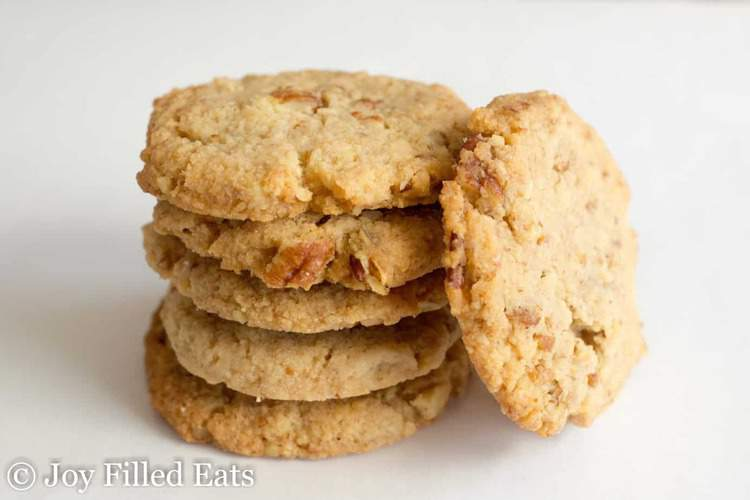 Butter Pecan Eggless Cookies stacked up with one on its side