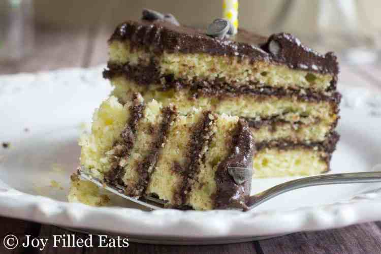 a bite of keto cake with four layers on a fork