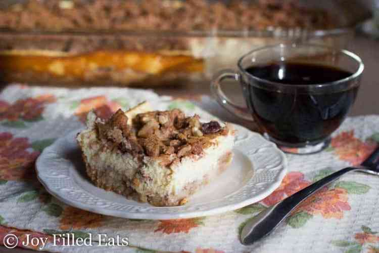 close up of one of the Butter Pecan Cheesecake Bars with a cup of coffee