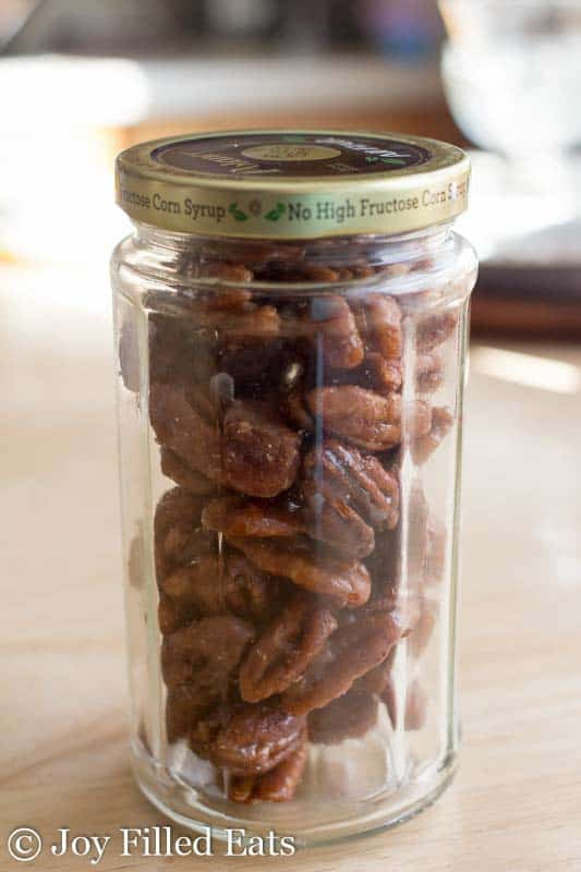 A recycled jelly jar of Glazed Pecans