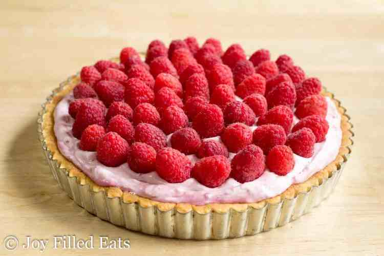 fresh raspberries on top of the tart