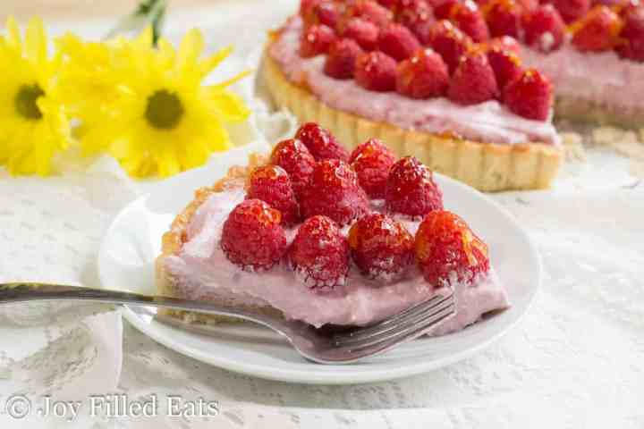 close up of a slice of raspberry tart