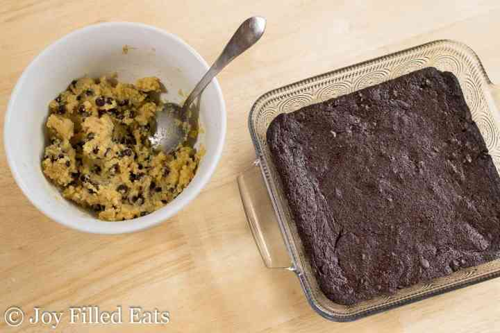 The mixing bowl of cookie dough and the baked brownies