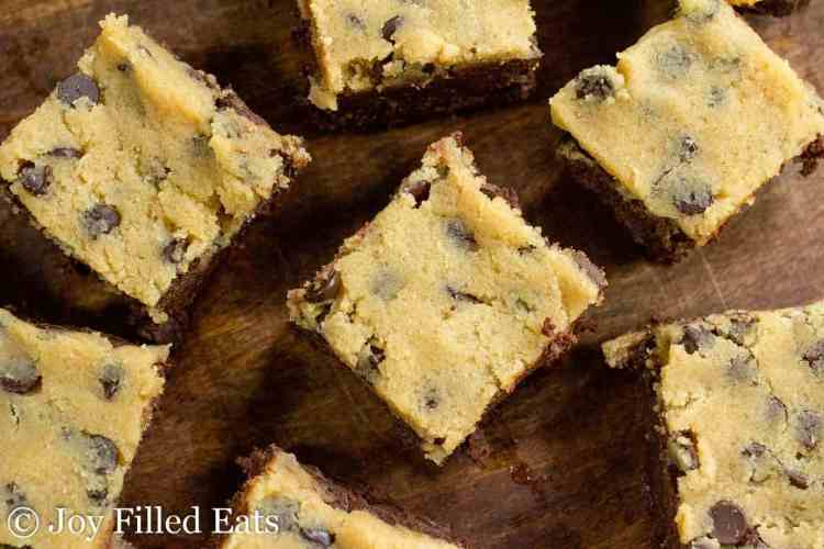 Overhead view of the healthy cookie dough brownies on a dark wood surface