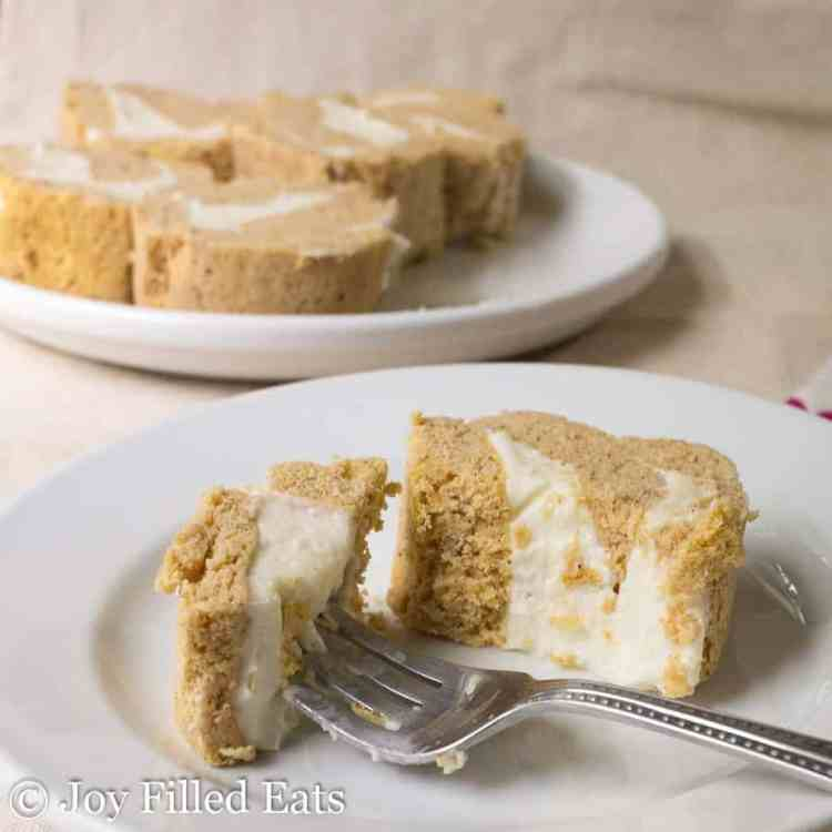 Mini Pumpkin Cake Roll with Cream Cheese Icing on a white plate