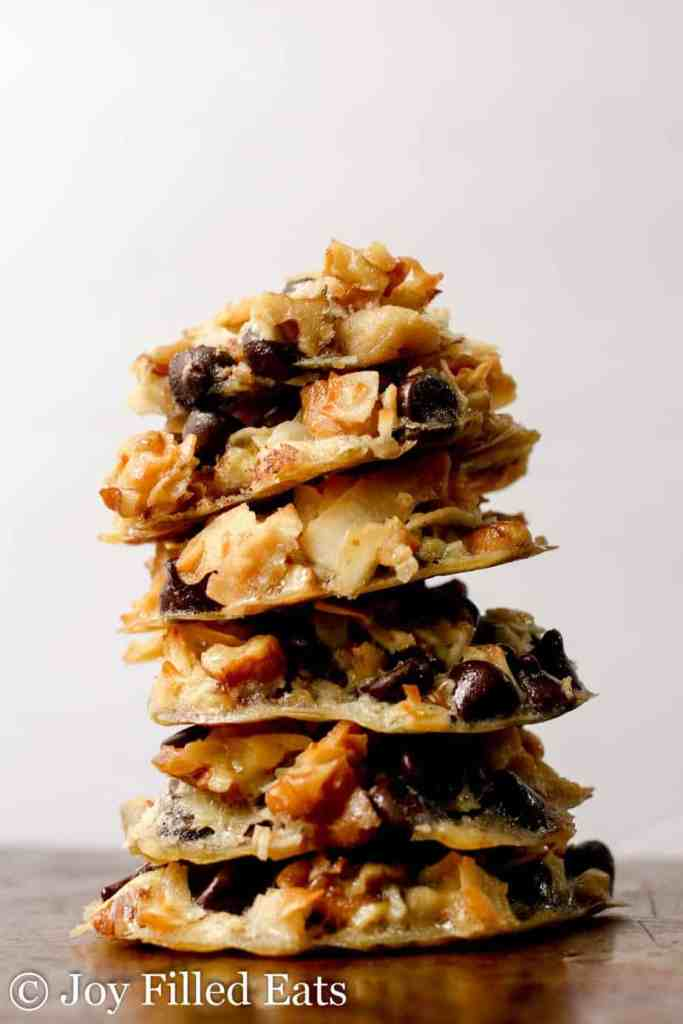 A tall stack of 6 magic keto cookies against a white background.