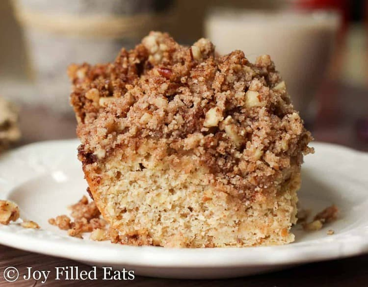 Cinnamon Pecan Crumb Cake on a white plate