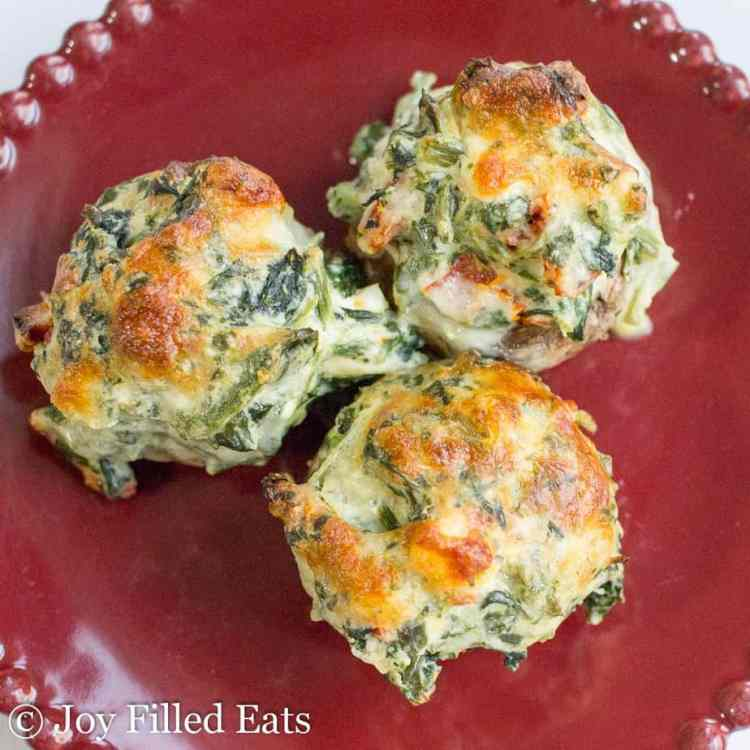 Tuscan Spinach Stuffed Mushrooms on a red plate
