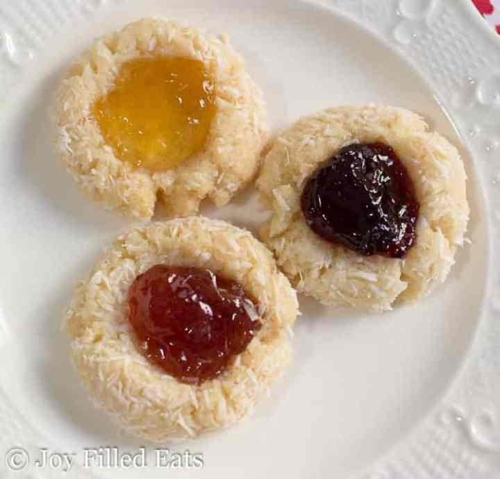 Jam Thumbprint Low Carb Cookies with different flavors of jam on a white plate