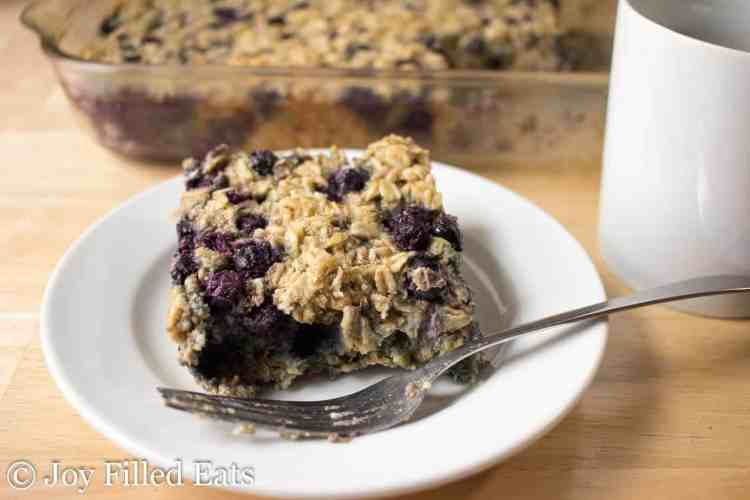 Close up of Healthy Baked Oatmeal on a white plate with a fork