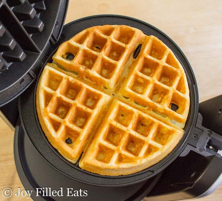 A cooked low carb waffle on the waffle iron.
