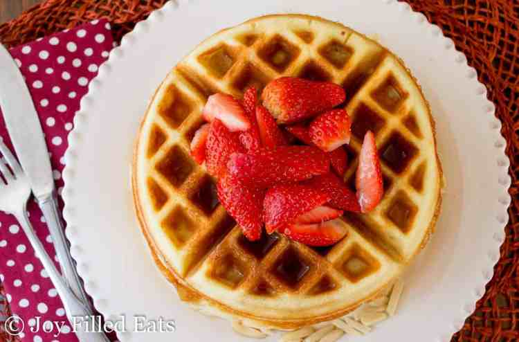 Overhead view of Low Carb Waffles on a white plate.
