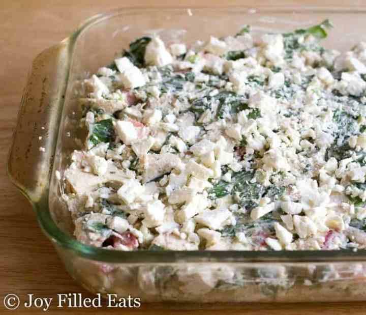 A glass casserole dish with the Mediterranean Chicken & Spinach Casserole.