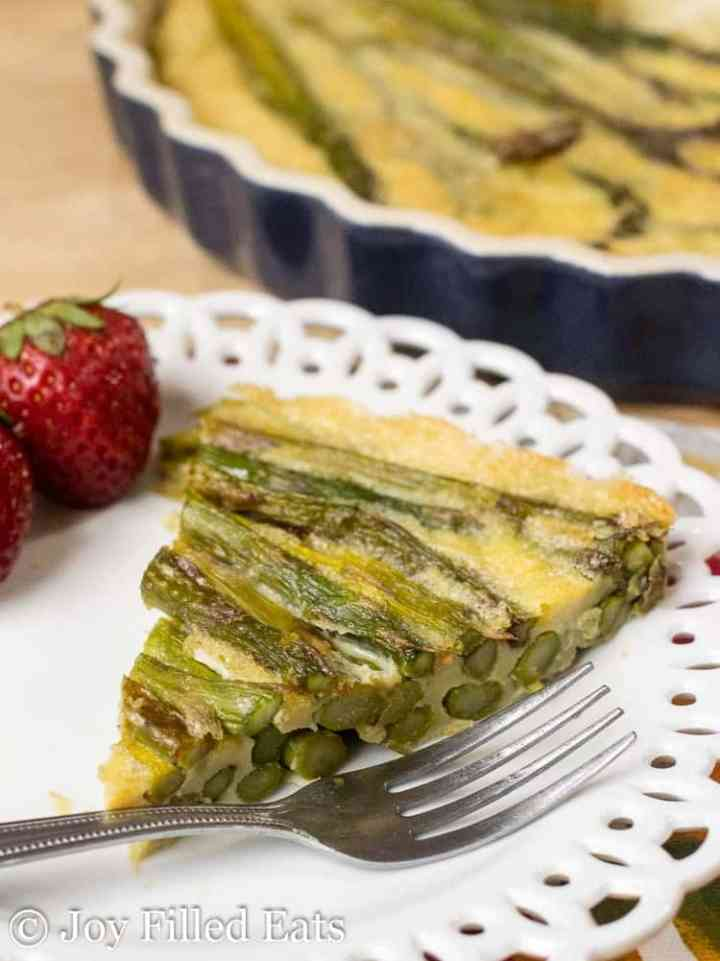 slice of Asparagus Quiche on a white plate