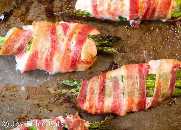 Cooked bacon wrapped asparagus chicken
