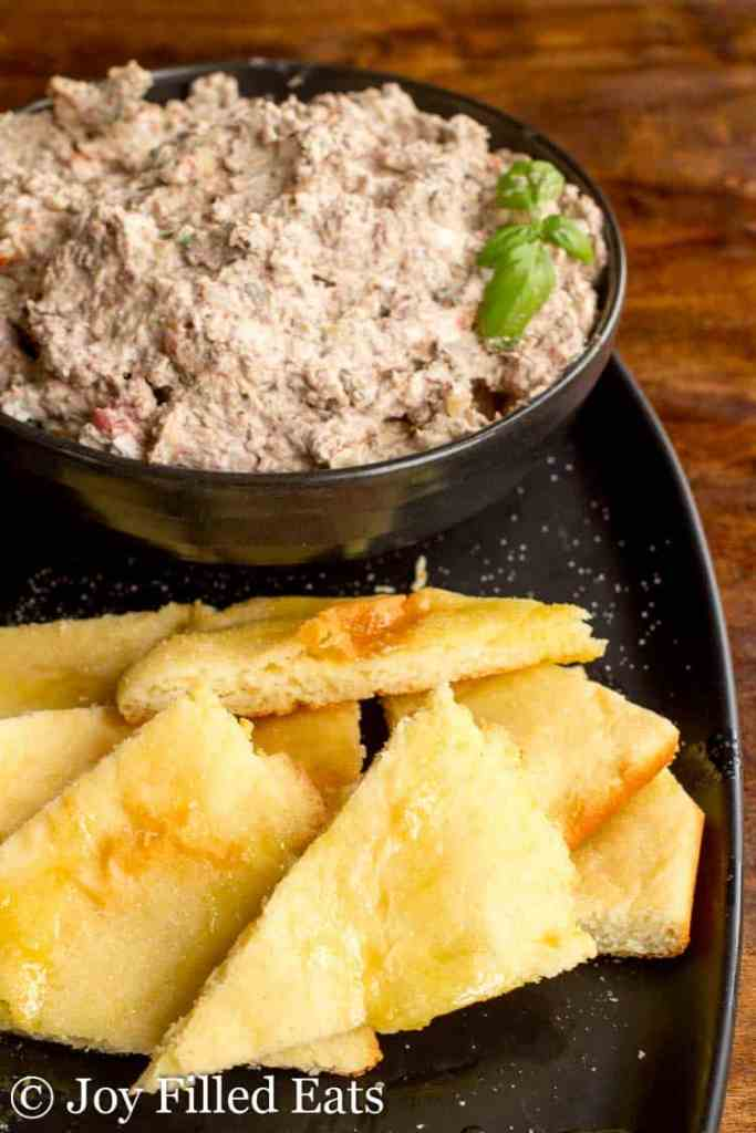 A bowl of Mediterranean Cheese Spread Recipe with Fathead Pita Dippers in the forehead