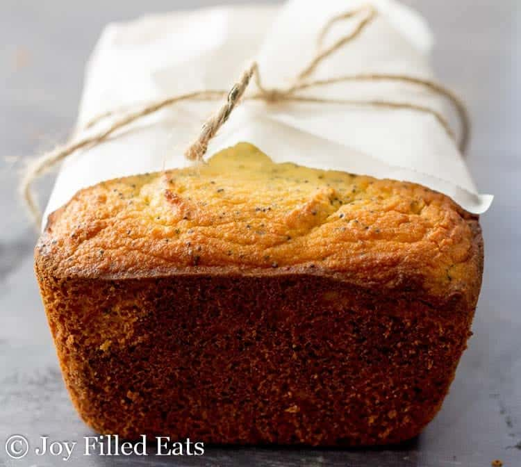 close up of the Lemon Poppy Seed Loaf Cake wrapped in parchment and tied with twine
