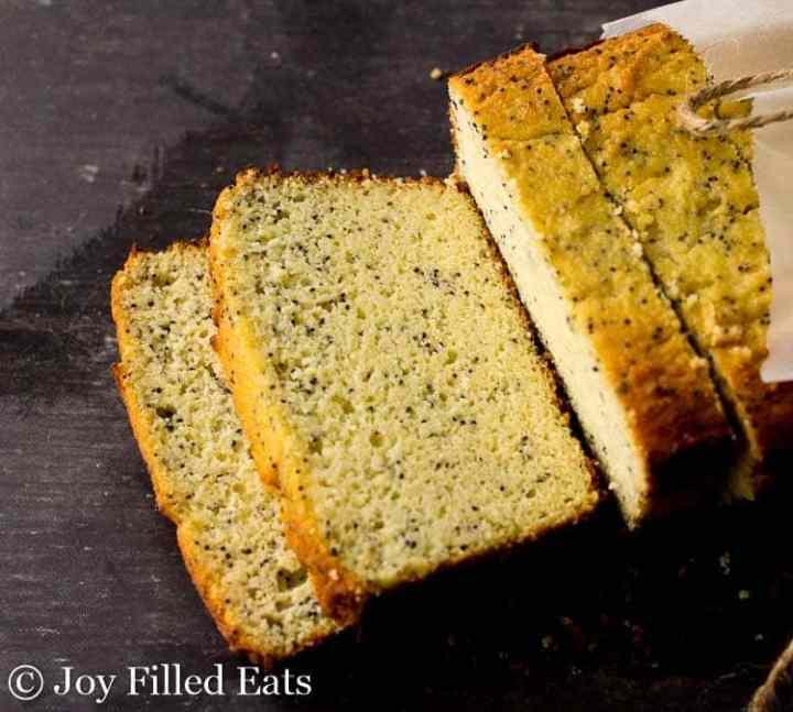 sliced Lemon Poppy Seed Loaf Cake on a dark surface