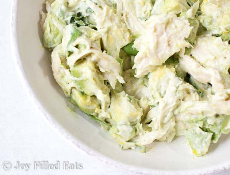 A close up of the mixed chicken salad with avocado