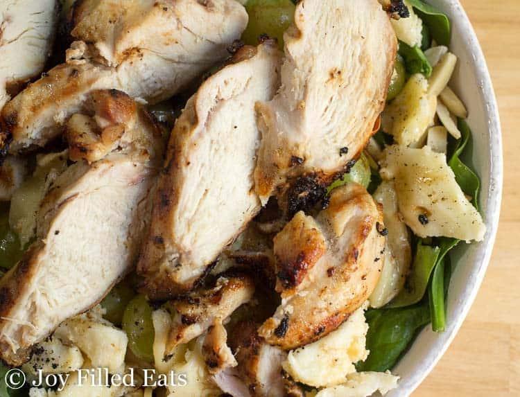 Lemon Grilled Chicken Marinade sliced chicken on top of a salad
