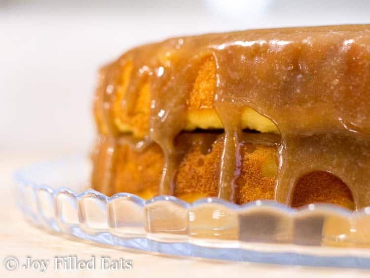 caramel dripping down the sides of the bananas foster cake