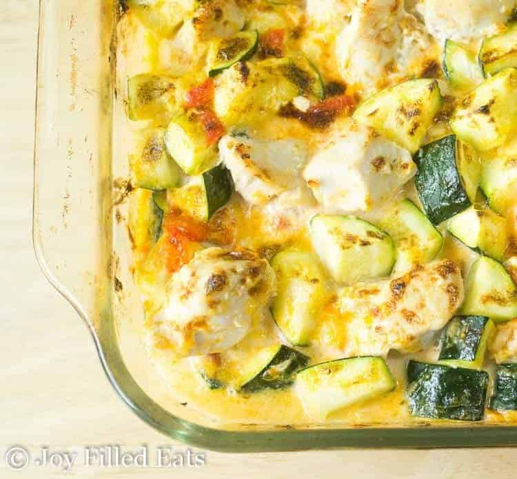 Overhead close up of the chicken zucchini casserole in a glass baking dish