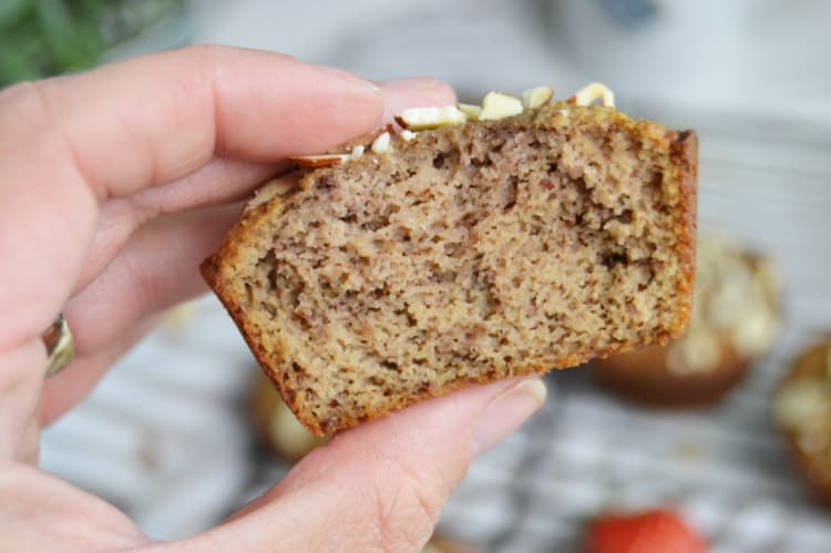 A hand holding a Low Carb Strawberry Almond Flour Muffin