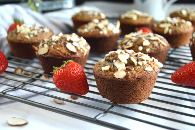 Strawberry Almond Flour Muffins on a cooling rack with whole berries