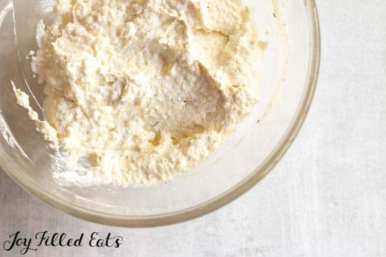 the creamy parmesan garlic sauce in a glass bowl