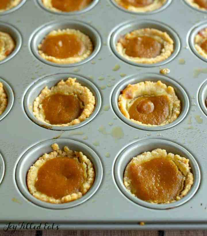 baked bite sized pumpkin pies in a muffin tin