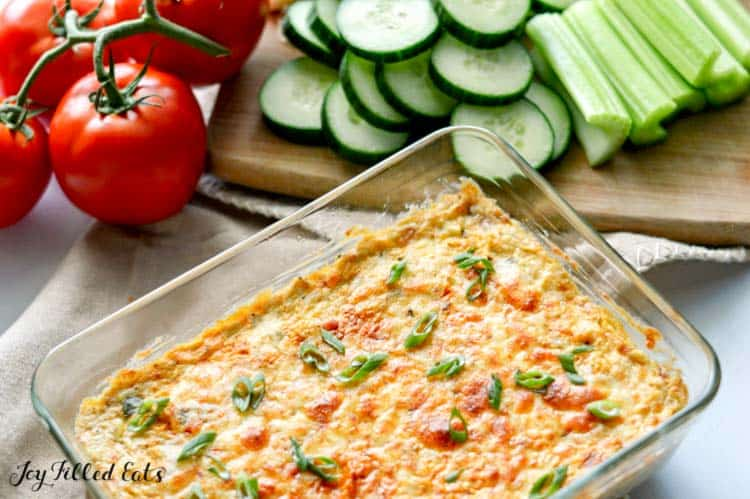 baked poblano artichoke dip with some cucumbers and celery