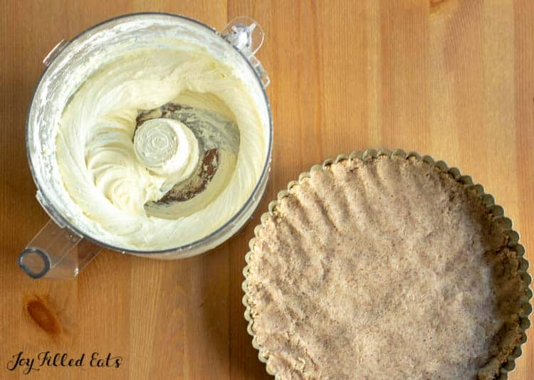 almond flour crust in a tart pan and cream cheese filling in the food processor