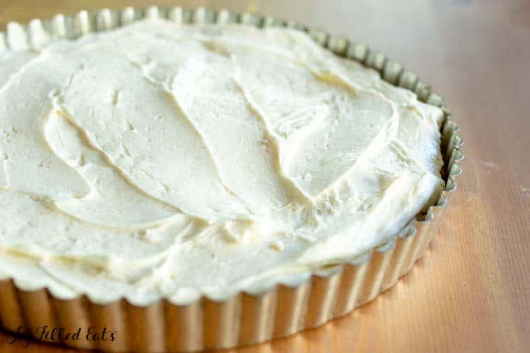 cream cheese filling in the prepare almond flour crust for the strawberry tart recipe