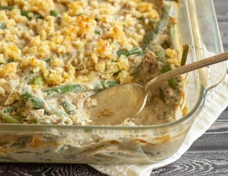 a spoon in the healthy green bean casserole recipe