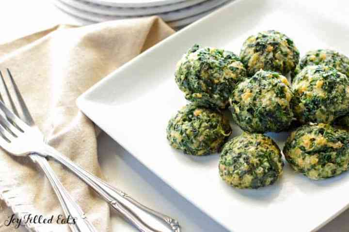 spinach balls on a white plate