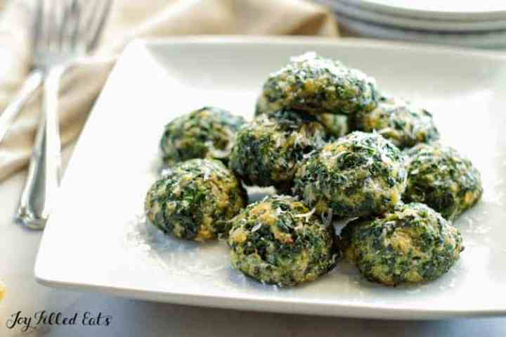 spinach balls piled up on a serving plate