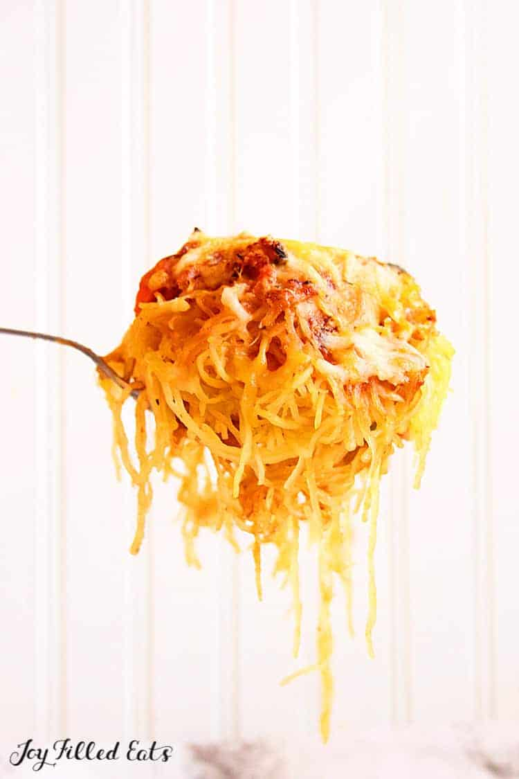 A fork scooping up the baked spaghetti squash