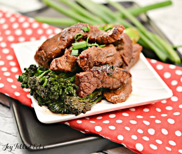 beef and broccoli on a white plate